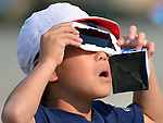 May 21, 2012, Tokorozawa, Japan - A Japanese school boy uses specially designed eye glasses, observing the annular solar eclipse in progress in Tokorozawa, Tokyos western suburbs on Monday, May 21, 2012...From southern Kyushu to Tohoku, northeastern Japan, some 83 million people along the Pacific Coasts observed the rare phenomenon, in which the moon blocks all but a ring of the suns light. In Tokyo, it was viewed for the first time in 173 years. (Photo by Natsuki Sakai/AFLO) AYF -mis-.