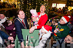 Kerry Captain Kierain Donaghy holding his daughter Lola Rose, Mayor Tom McEllistrim, Emma Lynch Caharlaheen NS winner of the christmas Colouring competition and  John Drummey turn on the Christmas lights in Tralee on Saturday last.
