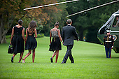United States President Barack Obama, First Lady Michele Obama,  and their daughters Sasha and Malia walk toward Marine One on the South Lawn of the White House in Washington, District of Columbia, U.S., on Saturday, Aug. 30, 2014. The First Family is traveling to Westchester County, New York to attend the wedding of senior policy advisor for nutrition policy and Let's Move Executive Director, Sam Kass to MSNBC host Alex Wagner. <br /> Credit: Pete Marovich / Pool via CNP