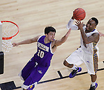 SIOUX FALLS, SD - MARCH 7: Deondre Parks #0 of South Dakota State goes for a layup over Western Illinois defender Jamie Batish #10 during the first round of a men's Summit League Championship Tournament game Saturday evening at the Denny Sanford Premier Center in Sioux Falls, SD.  (Photo by Ty Carlson/Inertia)