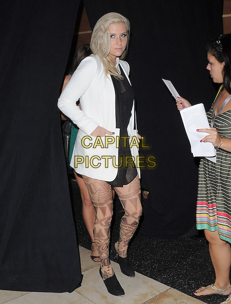 "Ke$ha, Kesha, Kesha Rose Sebert.""The Book of Mormon"" Hollywood Opening night Held At The Pantages theatre, Hollywood, California, USA..September 12th, 2012.full length white blazer black dress pattern tights hand in pocket .CAP/DVS.©DVS/Capital Pictures."