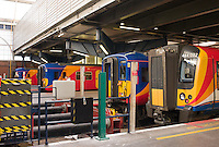 Colorful South West Trains (SWT) passenger trains waiting for departure at London Waterloo Station