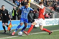 Blackpool's Nathan Delfouneso under pressure from Fleetwood Town's Lewis Gibson<br /> <br /> Photographer Kevin Barnes/CameraSport<br /> <br /> The EFL Sky Bet League One - Fleetwood Town v Blackpool - Saturday 7th March 2020 - Highbury Stadium - Fleetwood<br /> <br /> World Copyright © 2020 CameraSport. All rights reserved. 43 Linden Ave. Countesthorpe. Leicester. England. LE8 5PG - Tel: +44 (0) 116 277 4147 - admin@camerasport.com - www.camerasport.com