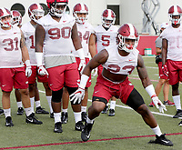 NWA Democrat-Gazette/DAVID GOTTSCHALK   Arkansas Razorback linebacker Dre Greenlaw runs through  drills Friday, July 28, 2017, during practice on campus in Fayetteville.