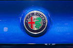 Manhattan, New York, USA. April 12, 2017.  New Alfa Romeo badge with red cross and green snake - traditional symbols of Milan, Itlay - is on trunk of Alfa Romeo displayed at the New York International Auto Show, NYIAS, during the first Press Day at the Javits Center.