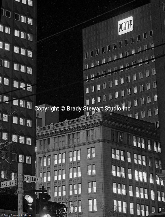 Pittsburgh PA: View of the H.K. Porter Company building and sign at night - 1953. HK Porter was known for building locomotives but diversified into many other industries after World War I.  Near the end of the depression, Porter declared bankruptcy and was purchased by Thomas Mellon Evans (part of the Mellon family).