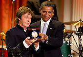 United States President Barack Obama presents former Beatle Paul McCartney the Gershwin Prize for Popular Song during a concert in the East Room of the White House in Washington, D.C., U.S., on Wednesday, June 2, 2010. The prize is awarded by the Library of Congress. .Credit: Andrew Harrer / Pool via CNP