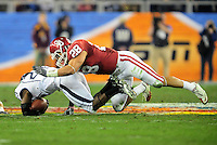 Jan. 1, 2011; Glendale, AZ, USA; Oklahoma Sooners linebacker (28) Travis Lewis makes a tackle against the Connecticut Huskies in the 2011 Fiesta Bowl at University of Phoenix Stadium. The Sooners defeated the Huskies 48-20. Mandatory Credit: Mark J. Rebilas-.