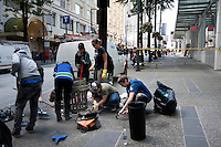 Strangers come together to help clean their city in downtown Vancouver, BC on June 16, 2011.  Rioters looted stores and burned cars after the Canucks' loss to the Boston Bruins in last night's Stanley Cup.  (photo copyright Karen Ducey 2011)