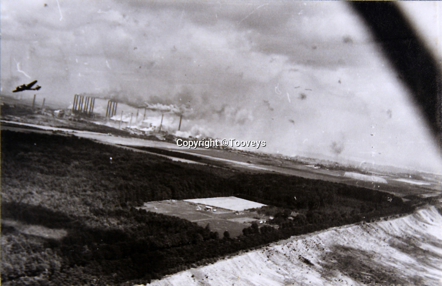 BNPS.co.uk (01202 558833)<br /> Pic:  Tooveys/BNPS<br /> <br /> Taken 12/08/41 - The power station at Knapsack, Cologne, during a daylight attack by Blenheims.  Note the flak bursts in the sky.<br /> <br /> Dramatic photos showing a series of heart-pounding World War Two bombing raids from the pilot's perspective have come to light.<br /> <br /> They were taken from Blenheim bombers undertaking attacks on targets in Germany and Nazi-occupied Netherlands in 1941.<br /> <br /> Several capture the immediate aftermath of a direct hit, with flames and clouds of smoke signifying they had achieved their aim.<br /> <br /> The album, which contains almost 100 photos, has emerged for sale with Toovey's Auctions, of Washington, west Sussex.