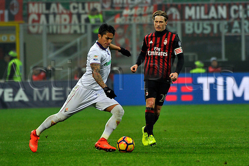 February 19th 2017, San Siro, Milan, Italy; Carlos Salcedo of Fiorentina passes before the challange of Ignazio Abate during  Serie A football, AC Milan versus Fiorentina;