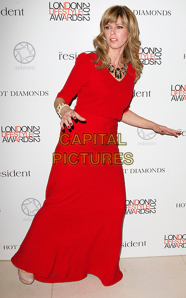 Kate Garraway.London Lifestyle Awards 2012 at The Hurlingham Club, London, England..October 17th 2012.full length red dress hands arms bending leaning funny .CAP/PP/CB.©Cliff Bass/PP/Capital Pictures.