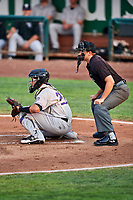Javier Guevara (22) of the Grand Junction Rockies during the game against the Ogden Raptors at Lindquist Field on September 6, 2017 in Ogden, Utah. Home plate umpire Thomas Fornarola calls the pitches. Ogden defeated Grand Junction 11-7. (Stephen Smith/Four Seam Images)