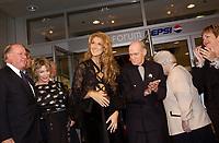 September 26. 2002, Montreal, Quebec, Canada; <br /> <br /> Bernard Landry, Quebec Premier (L) watch as<br /> Celine Dion, her husband Rene Angelil   and her parents unveil her Bronze Star at the Pepsi Forum's Walk of Fame, September 26 2002, Montreal, CANADA.