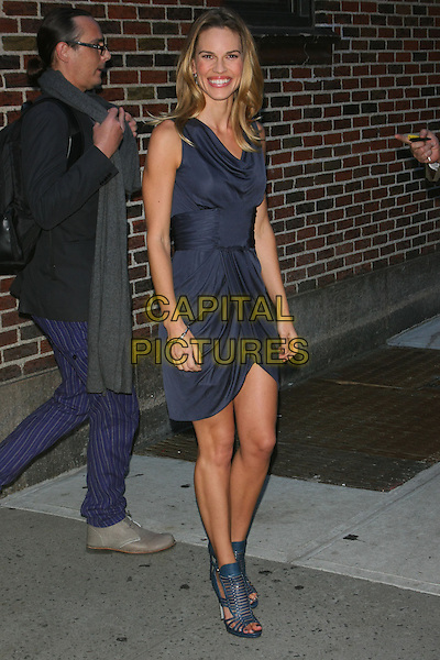 HILARY SWANK.Hilary Swank at the Ed Sullivan Theater for an appearance on the 'Late Show with David Letterman', New York, NY, USA..October 13th, 2010.full length dress draped sleeveless blue strappy sandals.CAP/LNC/TOM.©LNC/Capital Pictures.