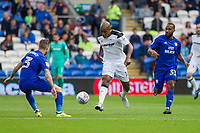 Andre Wisdom of Derby County gets between Joe Bennett and Junior Hoilett of Cardiff City during the Sky Bet Championship match between Cardiff City and Derby County at Cardiff City Stadium, Cardiff, Wales on 30 September 2017. Photo by Mark  Hawkins / PRiME Media Images.