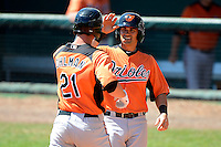 Baltimore Orioles catcher Zane Chavez greets Michael Ohlman (21) after hitting a home run during a minor league Spring Training game against the Atlanta Braves at Al Lang Field on March 13, 2013 in St. Petersburg, Florida.  (Mike Janes/Four Seam Images)