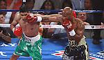 En disputa desarrollada en el Mandalay Resort and Casino de Las Vegas, Nevada, Amir Khan retuvo su cinturón superligero de la Asociación Mundial de Boxeo, al noquear en un controversial golpe a Zab Judah, quien cedió su cetro respaldado por la Federación Internacional de Boxeo.