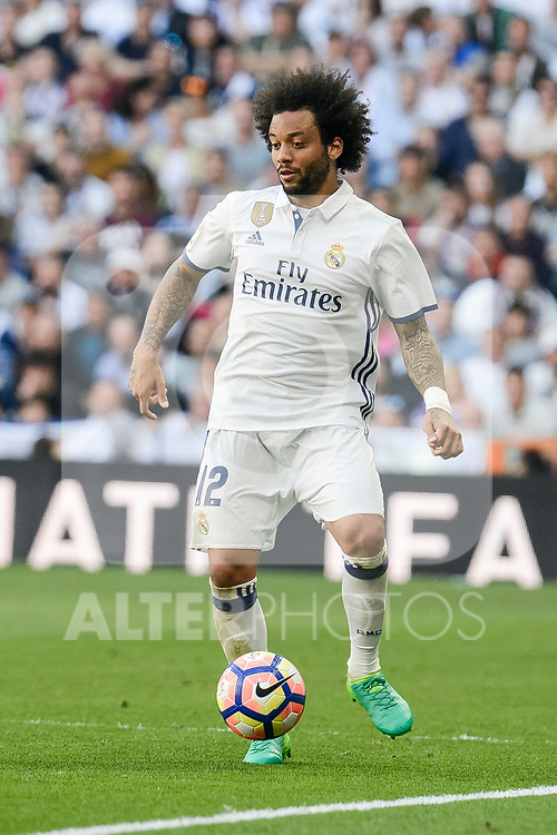 Real Madrid's Marcelo during La Liga match between Real Madrid and Atletico de Madrid at Santiago Bernabeu Stadium in Madrid, April 08, 2017. Spain.<br /> (ALTERPHOTOS/BorjaB.Hojas)