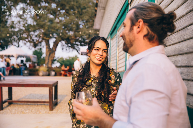 Couple talking at an outdoor wine event.