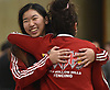 Girls saber winner Erica Chen of Half Hollow Hiills, left, center, hugs teammate Julia Jassey during the Brentwood Holiday Tournament at Brentwood High School on Saturday, Dec. 15, 2018.