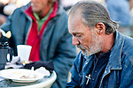 """Jan 10, 2010 - PHOENIX, AZ: RALPH, a homeless man in Phoenix, bows his head in prayer during breakfast at CrossRoads United Methodist Church in Phoenix, AZ. The church has been ordered by city zoning officials to stop serving breakfast to the homeless and indigent on Saturday mornings. The church started serving breakfast to the homeless in Jan. 2009 and shortly after that neighbors in the upscale area of Phoenix complained to city officials that the church was in violation of zoning ordinances. The city found the church was operating a """"charity kitchen"""" and ordered them to stop serving the breakfast. Rev. Dottie Escobedo-Frank, the pastor of the church, has said the church will file an appeal in US District Court and continue serving the breakfast until the appeals process is exhausted. About 150 people attend the Saturday breakfast each week. Some walk to the church from the alleys they live in in the neighborhood, others are bused to the breakfast by the church, which sens a bus in 1.5 mile radius from the church.         Photo by Jack Kurtz"""