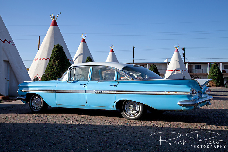 Located on Route 66 in Holbrook, Arizona, Wigwam Village #6 was built by Chester E. Lewis in 1950 and based on the original plans patented by Frank A. Redford in 1936. The motel consist of fifteen concrete and steel teepees, each with a base diameter of 14 feet, clustered around a main office building. Lewis operated the motel until 1974 when the Interstate bypassed downtown Holbrook. Chester died in 1986 and two years later his sons Clifton, Paul, and daughter Elinor renovated the motel and reopened it in 1988.<br /> <br /> Wigwam Village #6 continues to be run by the Lewis family. In keeping with the originality theme the rooms contain the original restored hickory furniture, two double beds, cable TV and a window mounted air conditioner; there are no telephones or Internet access. A number of Vintage restored automobiles from the 1960s and earlier are located throughout the parking area.<br /> <br /> Of the original seven Wigwam Villages that were built Wigwam Village #6 is one of three that remains. The other two are located in Rialto, California, also on Route 66, and Cave City, Kentucky. In 2006 the motel was placed on the National Register of Historic Places.