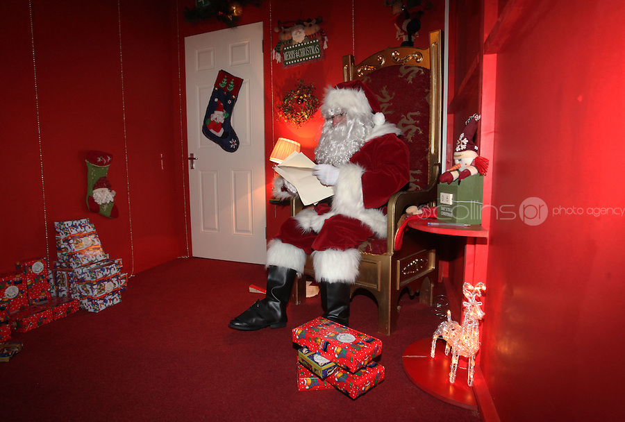 ****NO FEE PIC ******.19/11/2011.Santa Claus reads childrens letters.at the opening of Santa's Playland in The Ambassador Theatre,Dublin.One of this Christmas' biggest events is coming!  Santa's Playland takes up residence at The Ambassador Theatre in preparation for this year's festive season.  The spectacular event opens on Saturday 19 November and runs until Friday 23 December. Santa's Playland will see children transported to a magical Christmas paradise.On entering Santa's Playland children will be treated to a special Christmas play time.  The Play Area is full of Christmas treats with bouncy castles, slides and Christmas displays..Photo: Gareth Chaney Collins