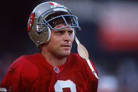SAN FRANCISCO, CA:  Quarterback Steve Young of the San Francisco 49ers stands on the field during a game at Candlestick Park in San Francisco, California in 1997. (Photo by Brad Mangin)