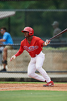 GCL Phillies East shortstop Logan Simmons (21) follows through on a swing during a game against the GCL Blue Jays on August 10, 2018 at Carpenter Complex in Clearwater, Florida.  GCL Blue Jays defeated GCL Phillies East 8-3.  (Mike Janes/Four Seam Images)