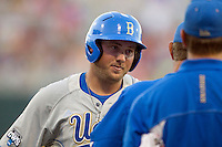 UCLA second baseman Cody Regis (18) talks with UCLA head coach John Savage during Game 8 of the 2013 Men's College World Series against the North Carolina State Wolfpack on June 18, 2013 at TD Ameritrade Park in Omaha, Nebraska. The Bruins defeated the Wolfpack 2-1, eliminating North Carolina State from the tournament. (Andrew Woolley/Four Seam Images)
