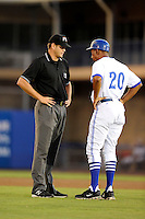Umpire Ryan Clark explains a call to Dunedin Blue Jays manager Bobby Meacham (20) during a game against the Fort Myers Miracle on July 20, 2013 at Florida Auto Exchange Stadium in Dunedin, Florida.  Fort Myers defeated Dunedin 3-1.  (Mike Janes/Four Seam Images)