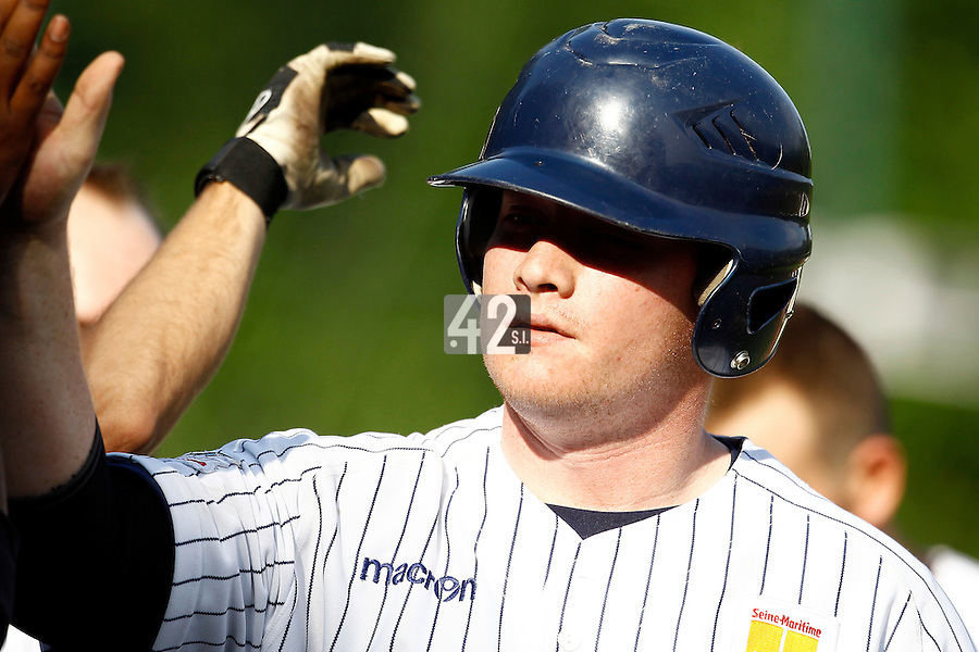 15 July 2011: Catcher David Gauthier of the Rouen Huskies celebrates during the 2011 Challenge de France match won 6-5 by the Rouen Huskies over the Senart Templiers at Stade Pierre Rolland, in Rouen, France.