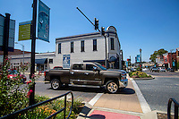 NWA Democrat-Gazette/JASON IVESTER <br /> Traffic passes on Friday, Aug. 14, 2015, through the intersection of Walnut Street and 2nd Street in downtown Rogers.