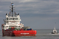 Voss Producer oil supply ship leaving Aberdeen Harbour guided by the Pilot Ship Sea Shepherd.