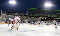 Nebraska-Omaha players warm-up prior to the outdoor game against North Dakota at TD Ameritrade Park in Omaha, Neb., Saturday, Feb. 9, 2013. (Photo by Michelle Bishop)