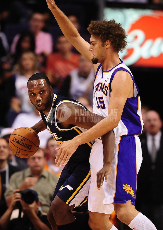 Oct. 12, 2010; Phoenix, AZ, USA; Utah Jazz center (25) Al Jefferson is defended by Phoenix Suns center (15) Robin Lopez during a preseason game at the US Airways Center. Mandatory Credit: Mark J. Rebilas-