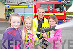 Children from the Danu? Childcare Centre, Rathmore summer camp, Caoimhe Guerin, Isabelle Whitty and Caoimhe Moynihan pictured with firefighter Brendan Connors, Killarney Fire and Rescue, during their visit to the Killarney Fire Station on Thursday.