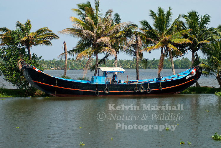 """A large Indian fishing boat tied up in the Alleppey Kerala """"Backwaters"""" - Southern India."""