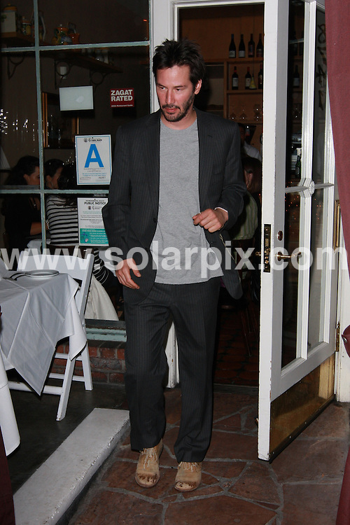 **ALL ROUND EXCLUSIVE PICTURES FROM SOLARPIX.COM**.**WORLDWIDE SYNDICATION RIGHTS**.**NO PUBLICATION IN AUSTRALIA, NEW ZEALAND,.DENMARK, GERMANY OR USA**.Keanu Reeves looks like he may have had too many drinks at Il Sole Restaurant in West Hollywood. Hollywood, California, USA. 5th October 2008..JOB REF: 7528 LAP (JS)      DATE: 05_10_2008.**MUST CREDIT SOLARPIX.COM OR DOUBLE FEE WILL BE CHARGED* *UNDER NO CIRCUMSTANCES IS THIS IMAGE TO BE REPRODUCED FOR ANY ONLINE EDITION WITHOUT PRIOR PERMISSION*