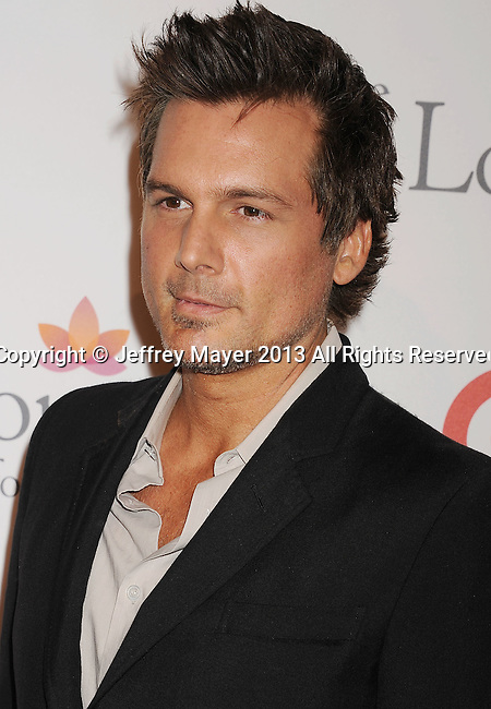 HOLLYWOOD, CA- SEPTEMBER 28: Director/producer Len Wiseman arrives at the Eva Longoria Foundation Dinner at Beso restaurant on September 28, 2013 in Hollywood, California.