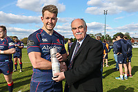 Jason Harries of London Scottish (left) received the man of the match award from London Scottish Director, Rod Lynch,  during the Greene King IPA Championship match between London Scottish Football Club and Nottingham Rugby at Richmond Athletic Ground, Richmond, United Kingdom on 15 April 2017. Photo by David Horn.
