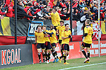 Mael Corboz #8 of the University of Maryland celebrates with teammates after scoring the game winning goal in the second half. Photo by: Greg Fiume