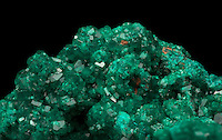 Close-up of dioptase crystals. Dioptase is a hydrous silicate of copper and often used as a gemstone. Renneville, Zaire, Africa.