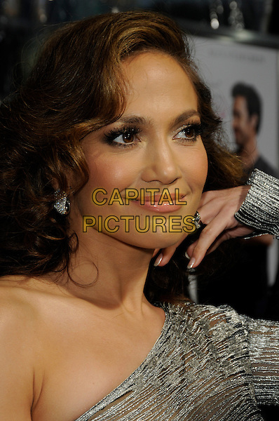 "JENNIFER LOPEZ .arriving at the premiere of CBS Films' ""The Back-up Plan"" at the Regency Village Theatre in Westwood, California, USA, April 21st, 2010..arrivals portrait headshot one shoulder silver earring wavy hair profile hand .CAP/ROT.©Lee Roth/Capital Pictures"