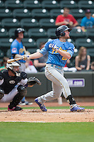 Billy McKinney (20) of the Myrtle Beach Pelicans follows through on his swing against the Winston-Salem Dash at BB&T Ballpark on May 10, 2015 in Winston-Salem, North Carolina.  The Pelicans defeated the Dash 4-3.  (Brian Westerholt/Four Seam Images)