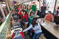 San Francisco, CA - Sunday, June 29, 2014: Mexico fans celebrate a goals at the SOMA StrEat Food Park watching the Netherlands vs. Mexico round of 16 World Cup match.