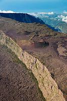 France, île de la Réunion, Parc national de La Réunion, classé Patrimoine Mondial de l'UNESCO, volcan du Piton de la Fournaise, l'Enclos Fouqué   au pied du Pas de Bellecombe, en fond  la Rivière des Remparts sur les pentes du volcan du Piton de la Fournaise  (vue aérienne) // France, Reunion island (French overseas department), Parc National de La Reunion (Reunion National Park), listed as World Heritage by UNESCO, Piton de la Fournaise volcano, Fouque enclosure at the foot of the Pas de Bellecombe (aerial view), in the background Riviere des Remparts, natural landscape of plain wedged between cliffs abrup ( aérial view)