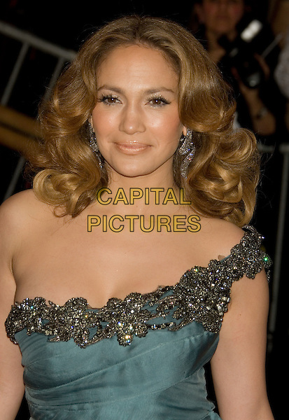 """JENNIFER LOPEZ.Costume Institute Gala - """"Superheroes: Fashion and Fantasy"""" at The Metropolitan Museum of Art, New York, NY, USA..May 5th, 2008 .headshot portrait green one shoulder dress jewel encrusted earrings .CAP/LNC/TOM.©TOM/LNC/Capital Pictures."""
