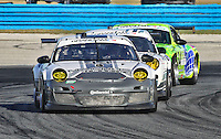 The #44 Porsche of Andy Lally, John Potter, Richard Lietz and Rene Rast en route to GT class victory at the Rolex 24 at Daytona, Daytona International Speedway, Daytona Beach, FL, January 2011.  (Photo by Brian Cleary/www.bcpix.com)